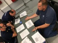 Men reviewing Fire Tech Training Content
